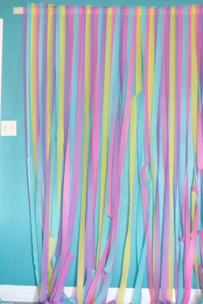 Here is a quick and cheap way to transform a wall into a back drop. There are so many different color options that are sure to fit any party you are hosting!