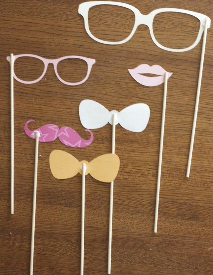 These photo booth props were such a hit at my little ones 1st birthday party! Not only were the kids excited but all the adults got in on the fun too!  Let me show you how easy they are to make!