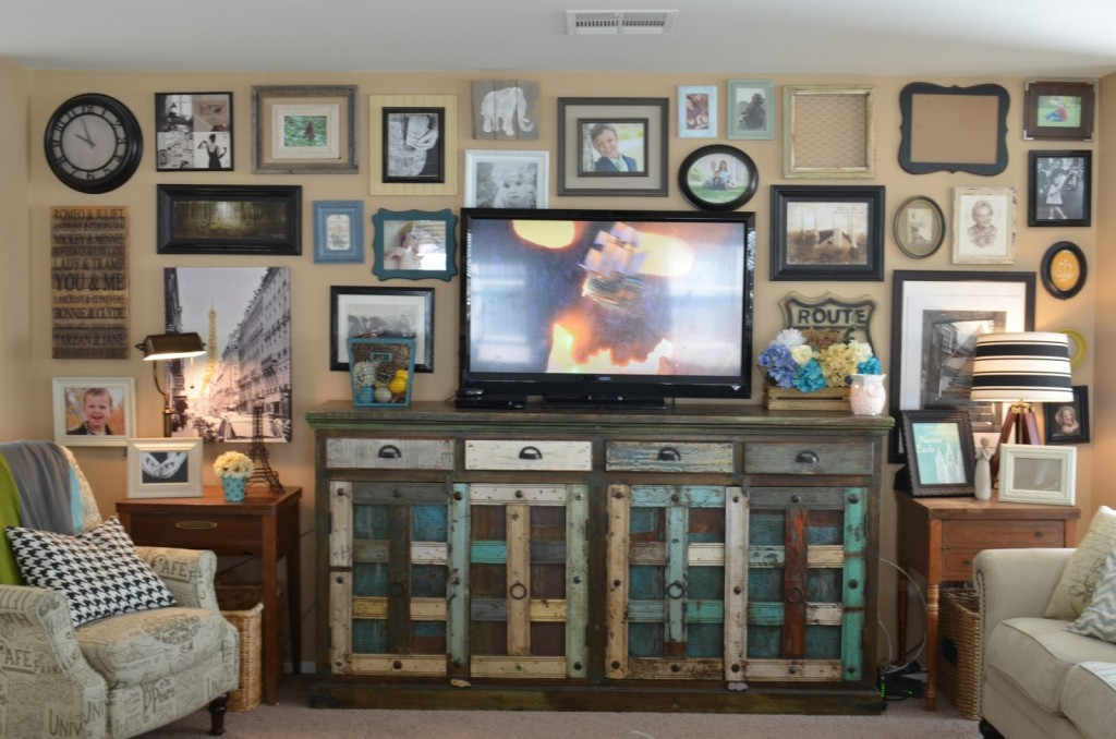 Do you have a boring wall behind your TV. I have rounded up 14 awesome ideas to help us all get inspiration on what do add behind the TV. So may get ideas!