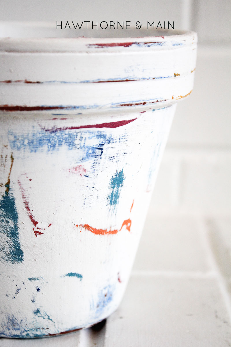 Check out this easy way to get a worn look on a flower pot. It looks like it was harder than it really was.  Come learn the splotchy paint technique.