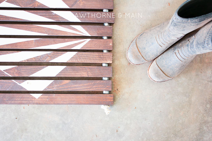 Check out this simple wood slat door mat! I love the geometric pattern that she added to it. This really would be so fun to make for our side entry to help with dirt!