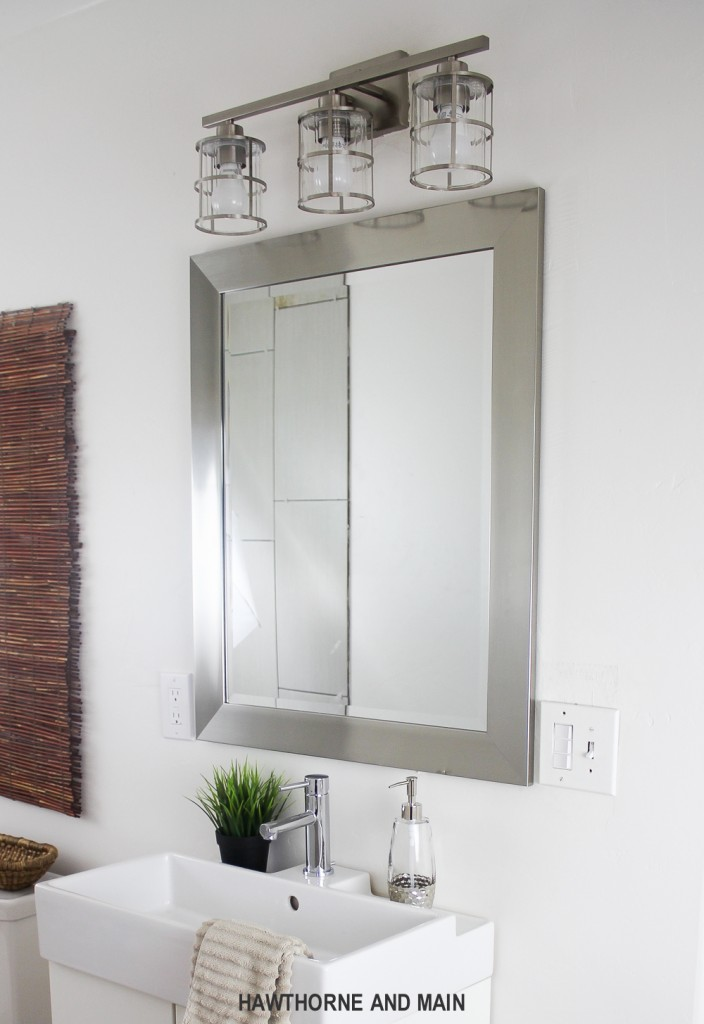 Simple bathroom update. I love that mirror and light. Such a great bathroom!