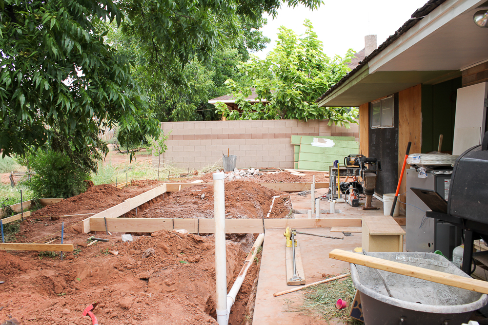 The Suite Pecan before- the outside was a totally disaster with just dirt and weeds. Here is what the space looked like before. Luckily it gets way better from here!