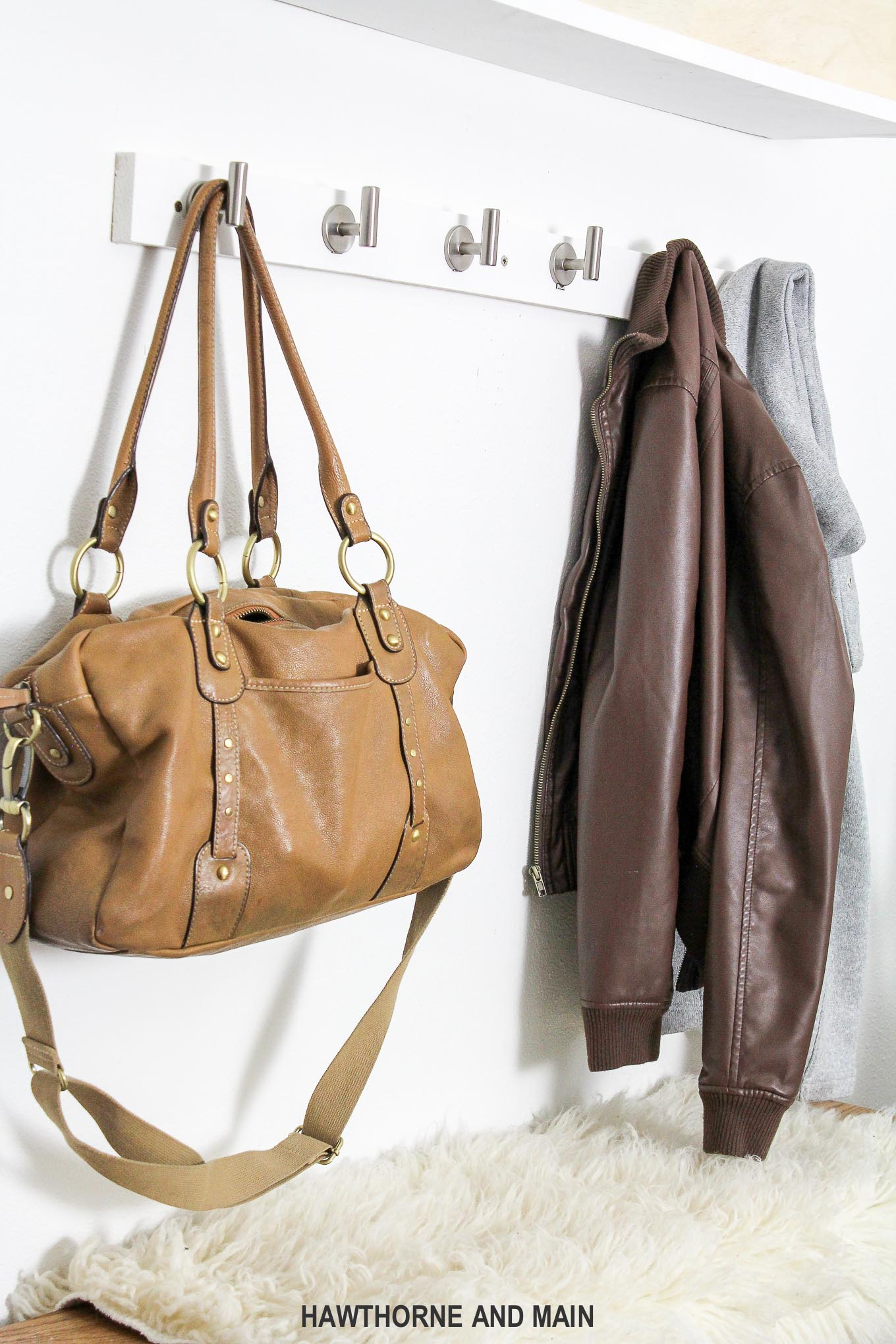 Learn how to make an inviting entryway with this simple diy coat rack